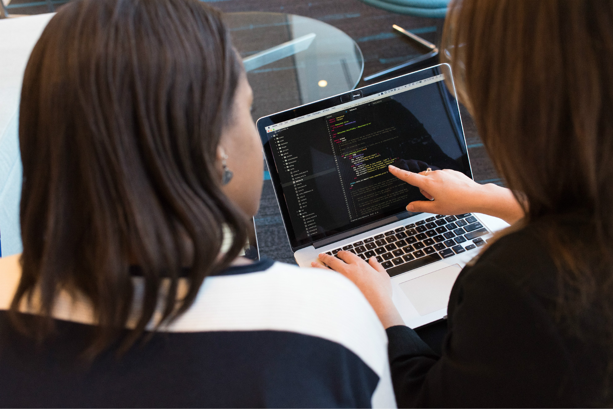 two-women-looking-at-the-code-at-laptop-1181263.jpg